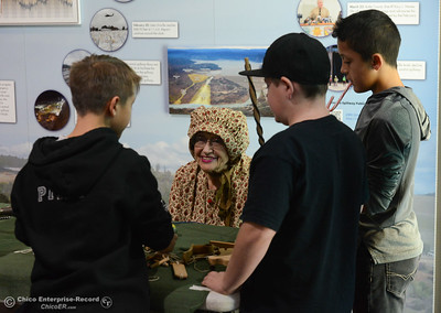 Barbara Ragland talks with kids about old fashion toys during Frontier Christmas Saturday December 2, 2017 at the at Lake Oroville Visitor Center in Oroville, California. (Emily Bertolino -- Mercury Register)