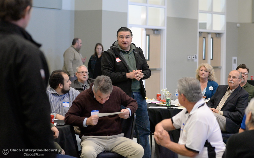 . Assembleyman James Gallagher and Assemby Member Dante Acosta, center, talk with local business leaders and other legislators as  they eat lunch and discuss the Lake Oroville Dam and spillway incident and current situation during a gathering at the Southside Community Center in Oroville, Calif. Thurs. Feb. 15, 2018. (Bill Husa -- Enterprise-Record)