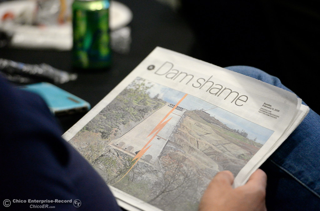 . People read both historic and recent literature related to Lake Oroville and the Lake Oroville Dam while Assembleyman James Gallagher and other legislators eat lunch and discuss the Lake Oroville Dam and spillway incident and current situation during a gathering at the Southside Community Center in Oroville, Calif. Thurs. Feb. 15, 2018. (Bill Husa -- Enterprise-Record)