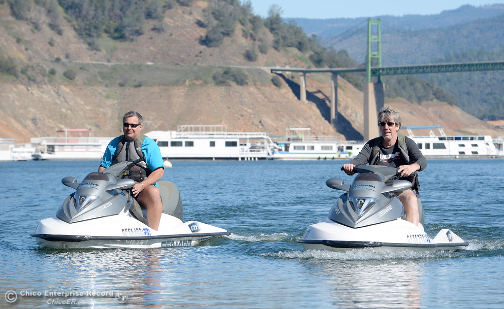 . Kurt Wick of Yuba City, left and Kevin Schinke of Sacramento ride personal watercraft at Lake Oroville Wednesday Feb. 21, 2018.  Wick said he was there to make a minor repair to a houseboat he has on the lake, which is also for sale. (Bill Husa -- Enterprise-Record)