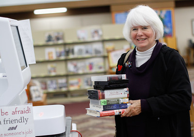 Alma Short checks out a variety of reading and audio books using the new self checkout system February 2, 2017 at the Oroville Branch in Oroville, California. (Emily Bertolino -- Enterprise-Record)
