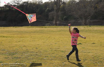 Leah Provance flies a kite for the first time in Riverbend Park, Thursday, March 8, 2018, in Oroville, California. (Carin Dorghalli -- Enterprise-Record)