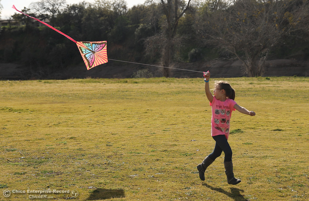 . Leah Provance flies a kite for the first time in Riverbend Park, Thursday, March 8, 2018, in Oroville, California. (Carin Dorghalli -- Enterprise-Record)