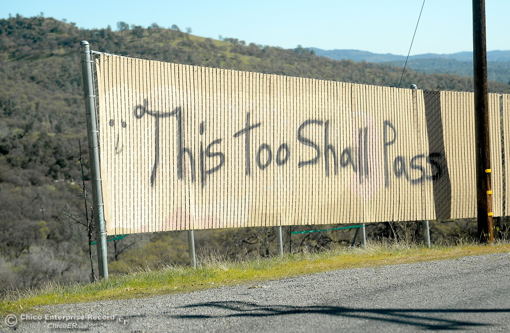 ". A sign is seen painted along a fence that reads ""This too shall pass\"" along Table Mountain Blvd. Monday March 5, 2018. Hikers 16-years or older are now required to have a Lands Pass or valid hunting or fishing license. (Bill Husa -- Enterprise-Record)"