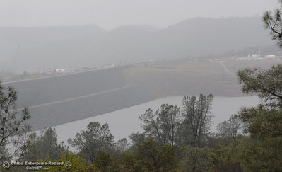 The Lake Oroville Dam is seen from the Oroville Visitors Center viewing platform in Oroville, Calif. Thurs. March 15, 2018. (Bill Husa -- Enterprise-Record)