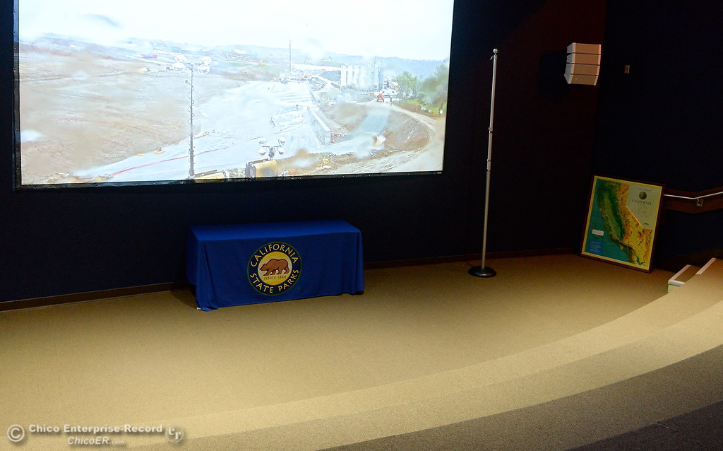 . A live camera feed of work going on around the Lake Oroville Dam plays in the Oroville Visitors Center Theatre in Oroville, Calif. Thurs. March 15, 2018. (Bill Husa -- Enterprise-Record)