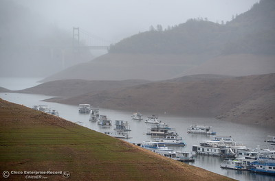 Houseboats float near Bidwell Canyon Marina as rain pours around Butte County Calif. Wednesday March 21, 2018.  (Bill Husa -- Enterprise-Record)