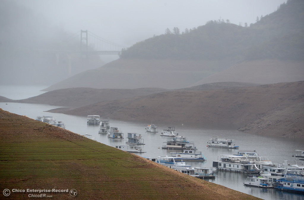 . Houseboats float near Bidwell Canyon Marina as rain pours around Butte County Calif. Wednesday March 21, 2018.  (Bill Husa -- Enterprise-Record)