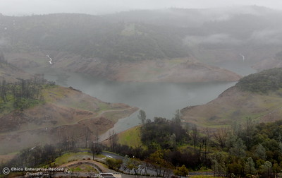 Water runnoff flows into Lake Oroville near the Nelson Bar Day use area as rain continues Wednesday March 21, 2018.  (Bill Husa -- Enterprise-Record)