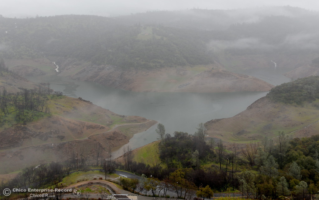 . Water runnoff flows into Lake Oroville near the Nelson Bar Day use area as rain continues Wednesday March 21, 2018.  (Bill Husa -- Enterprise-Record)