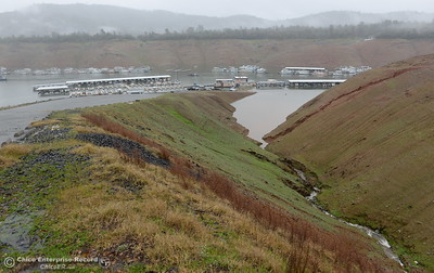 Water flows into Lake Oroville near Bidwell Canyon Marina as rain pours around Butte County Calif. Wednesday March 21, 2018.  (Bill Husa -- Enterprise-Record)