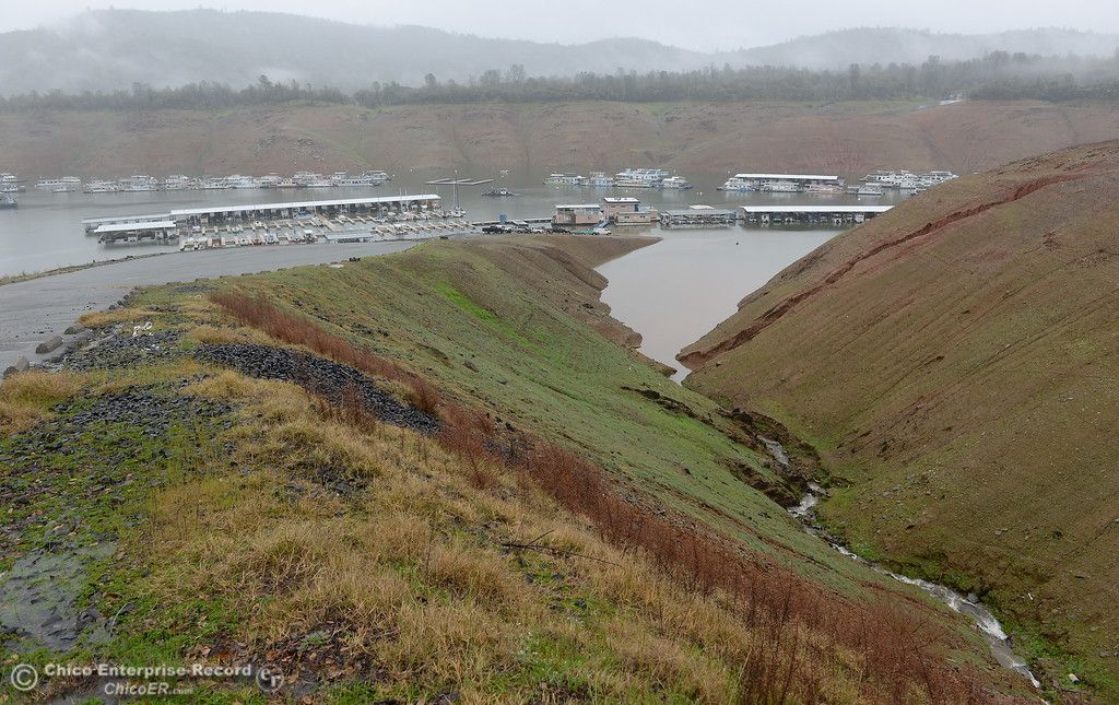 . Water flows into Lake Oroville near Bidwell Canyon Marina as rain pours around Butte County Calif. Wednesday March 21, 2018.  (Bill Husa -- Enterprise-Record)