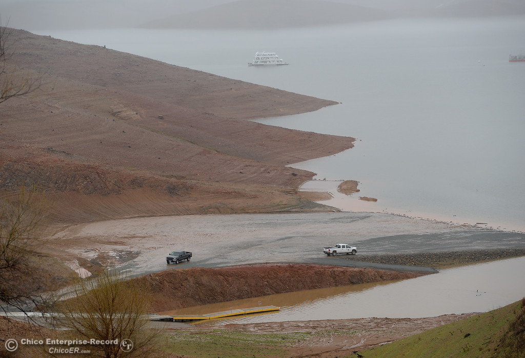 . The main launch facility is back in use as water levels continue to rise in Lake Oroville near Bidwell Canyon Marina, seen here as rain pours around Butte County Calif. Wednesday March 21, 2018.  (Bill Husa -- Enterprise-Record)