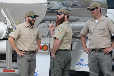 "Fish & Wildlife Technicians Adam Anton, Joe Amoroso and David Lunsford left to right relax after releasing roughly one million endangered baby Chinook Salmon into the Feather River at the Boyd Pump Boat Ramp near Yuba City, Calif. Mon. March 20, 2017. Fish & Wildlife Technician Dave Lunsford said These are the ones that survived the mud when the spillway failed, It's amazing they're still alive.""  (Bill Husa -- Enterprise-Record)"