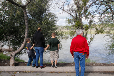 A family stops at Bedrock Park to check out high level of the Feather River March 21, 2017 in Oroville,California. (Emily Bertolino -- Enterprise-Record)