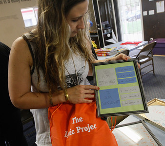 "Heather Halverson holds up a unique item found in each Lyric Project bag, a framed ""I am"" board full of positive affirmations children who have recently been placed in foster care can say to themselves  March 20, 2017  in Oroville,California. (Emily Bertolino -- Enterprise-Record)"