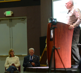 Butte County Sheriff Kory Honea, right, reviews the Oroville evacuation plan Friday, March 24, 2017, at Church of the Nazarene in Oroville, California, during a the second of four scheduled meetings. Oroville Mayor Linda Dahlmeier, left, and Butte County District Attorney Mike Ramsey, center, listen as the sheriff speaks. (Dan Reidel -- Mercury-Register)