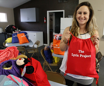 Heather Halverson holds up a Lyric Project bag, a project she started after learning from her experience of losing her daughter Lyric as she struggled with addiction; now she hopes to give back by bringing these to children who have recently be placed in foster care March 20, 2017  in Oroville,California. (Emily Bertolino -- Enterprise-Record)