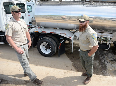 "Left to right, Fish & Wildlife Technicians Dave Lunsford and Joe Amoroso breath easy after unloading fish into the Feather River Monday. Lunsford said, ""These are the ones that survived the mud when the spillway failed, It's amazing they're still alive.""   Roughly one million endangered baby Chinook Salmon that were saved by Department of Fish & Wildlife Technicians at the Feather River Fish Hatchery during the Oroville Spillway failure are released into the Feather River at the Boyd Pump Boat Ramp near Yuba City, Calif. Mon. March 20, 2017.  (Bill Husa -- Enterprise-Record)"