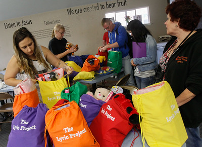 Founder of the Lyric Project, Heather Halverson, left and volunteers pack bags to give to children who have recently be placed in foster care March 20, 2017  in Oroville,California. (Emily Bertolino -- Enterprise-Record)