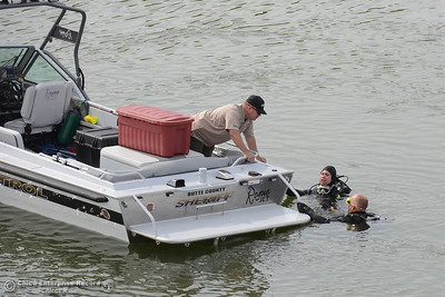 Divers report that they found a car on its roof at the bottom of the canal Friday, April 8, 2016, that takes water from the Thermalito Forebay in Oroville, California. The car appears to have continued on Grand Avenue after the road ended, crashed through a chain-link fence and jumped a barbed wire fence, continuing in the air down a 50-foot embankment before landing in the water. (Dan Reidel -- Mercury-Register)