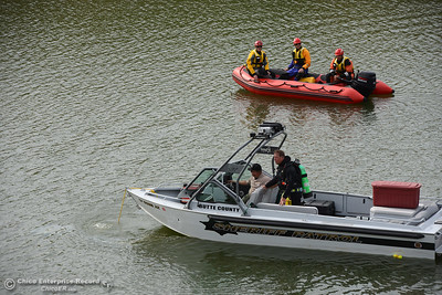 Divers find a car with a body inside Friday, April 8, 2016, in the canal that transports water from the Thermalito Forebay to the Thermalito Afterbay in Oroville, California. Debris at the scene indicates the decedent continued driving on Grand Avenue and vaulted into the canal, although investigators could not determine whether it was intentional or an accident. (Dan Reidel -- Mercury-Register)