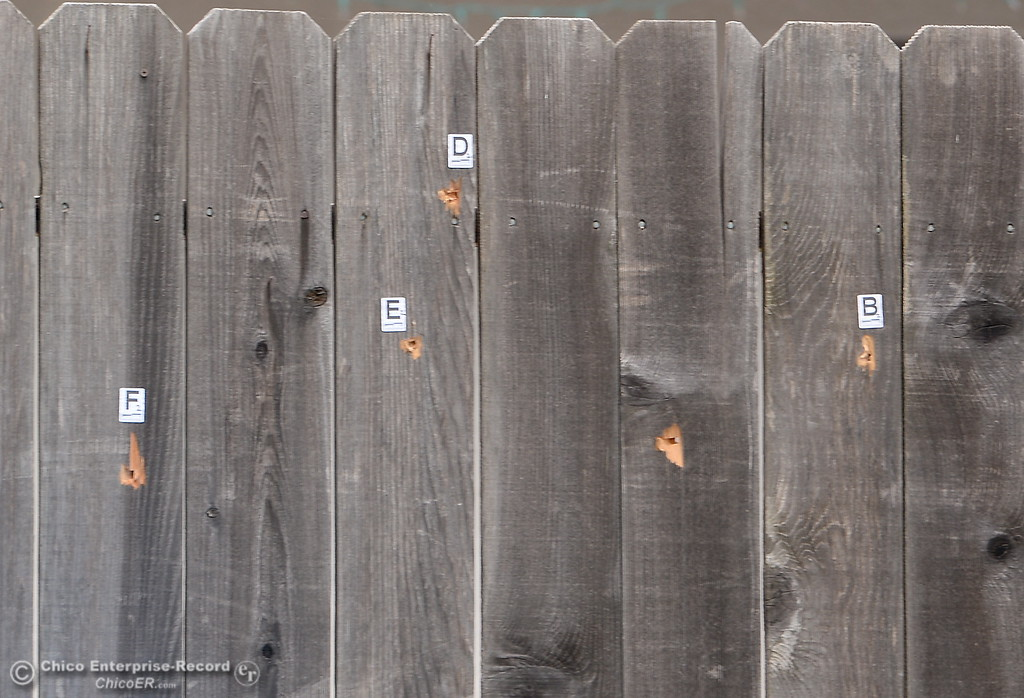 . A home where Larry Siordia was shot and killed by a Butte County Sheriff\'s Sgt. Saturday has bullet holes marked in the fence in Oroville, Calif. Wed. April 11, 2018. (Bill Husa -- Enterprise-Record)