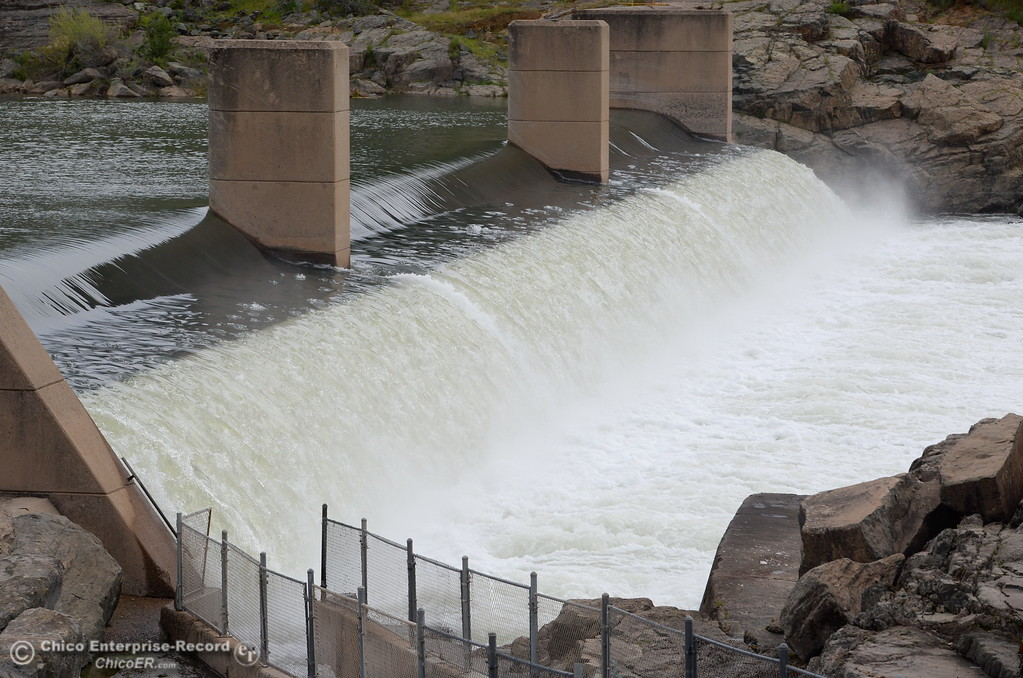 . Water flows over the Fish Barrier Dam near the Feather River Fish Hatchery in Oroville, Calif. Wed. April 11, 2018. (Bill Husa -- Enterprise-Record)