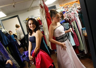 Brittney Vongunten and Michaelyn Defronzo try on prom dresses during the 14th annual Prom Project Thursday April 13, 2017 at The Axiom in Oroville, California. The annual Prom Project offers free formal attire and accessory for Butte County youth Friday 3:30-5:30 p.m and Saturday 10 a.m. to 3 p.m. (Emily Bertolino -- Mercury Register)
