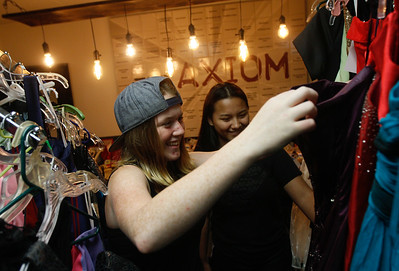 Kendra Franks and Angie Fones look for prom dresses during the 14th annual Prom Project Thursday April 13, 2017 at The Axiom in Oroville, California. The annual Prom Project offers free formal attire and accessory for Butte County youth Friday 3:30-5:30 p.m and Saturday 10 a.m. to 3 p.m. (Emily Bertolino -- Mercury Register)