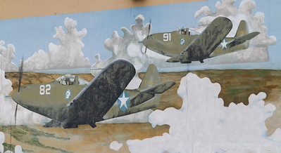 A mural of fighter planes marked with United State military insignia tells of Oroville's connection to World War ll Tuesday April 11, 2017 in Oroville, California. The City of Oroville built the Oroville Municipal Airport in 1933 and it served as a WWll training base. (Emily Bertolino -- Mercury Register)