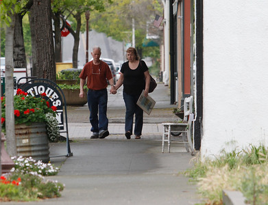A couple takes a strolls around downtown Oroville before stopping in at an antique shop Tuesday April 11, 2017 in Oroville, California. (Emily Bertolino -- Mercury Register)