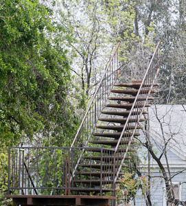 A stairway to nowhere stands detached from an abandoned building Tuesday April 11, 2017 in Oroville, California. (Emily Bertolino -- Mercury Register)