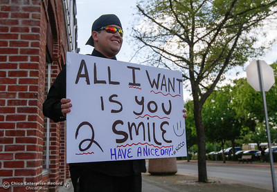 "A man stands at the corner of Meyers and Montgomery waving a sign at cars as they pass that reads, "" All I want is you 2 Smile,"" April 11, 2016 in Oroville, California. ""I try to always do little stuff to brighten peoples days,"" he says. ""It's about making others days better.""  (Emily Bertolino -- Mercury Register)"