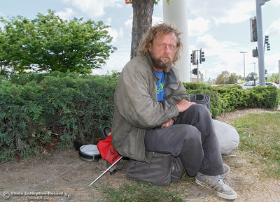 "Kenneth hangs out on the corner of Oro Dam and Feather River Blvd as he travels through Oroville Monday April 10, 2016 in Oroville, Calif. ""If you have $5 and a cotton shirt on your back, your not homeless,"" he says. (Emily Bertolino -- Enterprise-Record)"