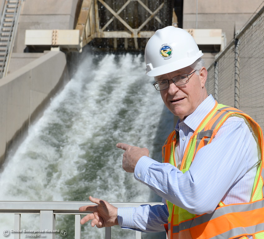 . Tony Meyers, project manager (overseeing restoration of Thermalito facilities) points out water flowing through the bypass gate at a rate of approx. 8,000 cfs while repairs are underway Wed. March 28, 2018.  (Bill Husa -- Enterprise-Record)