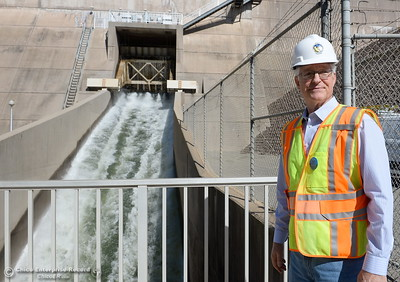 Tony Meyers, project manager (overseeing restoration of Thermalito facilities) smiles beside the bypass gate with water flowing at a rate of approx. 8,000 cfs while repairs are underway Wed. March 28, 2018.  (Bill Husa -- Enterprise-Record)