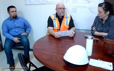 At left, Armando Ortiz, assistant project manager (for Thermalito facilities)  and Erin Mellon, assistant director of public affairs at right, listen whiel Bryan Coulter, Thermalito site safety consultant goes over safety items prior to a tour of the Thermalito Power Plant in Oroville, Calif. Wed. March 28, 2018.  (Bill Husa -- Enterprise-Record)
