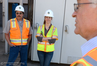 Pat Whitlock, Oroville field division chief and Erin Mellon, assistant director of public affairs left to right listen while Tony Meyers, project manager (overseeing restoration of Thermalito facilities) talks about work currently underway at the The Ronald R. Robie Thermalito Power Plant located in Oroville, Calif. Wed. March 28, 2018.  (Bill Husa -- Enterprise-Record)