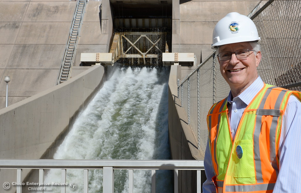 . Tony Meyers, project manager (overseeing restoration of Thermalito facilities) smiles beside the bypass gate with water flowing at a rate of approx. 8,000 cfs while repairs are underway Wed. March 28, 2018.  (Bill Husa -- Enterprise-Record)