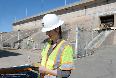 Erin Mellon, assistant director of public affairs signs in during a tour of the Thermalito Power Plant in Oroville, Calif. Wed. March 28, 2018.  (Bill Husa -- Enterprise-Record)