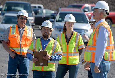 Pat Whitlock, Oroville field division chief, Armando Ortiz, assistant project manager (for Thermalito facilities), Erin Mellon, assistant director of public affairs, Risa Johnson, Enterprise-Record Reporter and Tony Meyers, project manager (overseeing restoration of Thermalito facilities) left to right talk during a tour of the Thermalito Power Plant in Oroville, Calif. Wed. March 28, 2018.  (Bill Husa -- Enterprise-Record)
