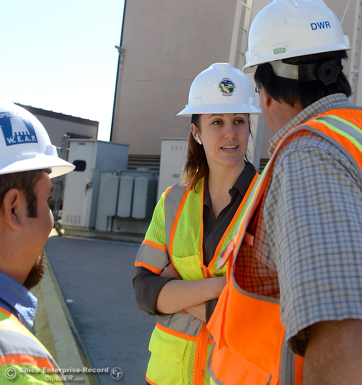 . Armando Ortiz, assistant project manager (for Thermalito facilites) Erin Mellon, assistant director of public affairs and Pat Whitlock, Oroville field division chief left to right, talk outside during a tour of the Thermalito Power Plant in Oroville, Calif. Wed. March 28, 2018.  (Bill Husa -- Enterprise-Record)