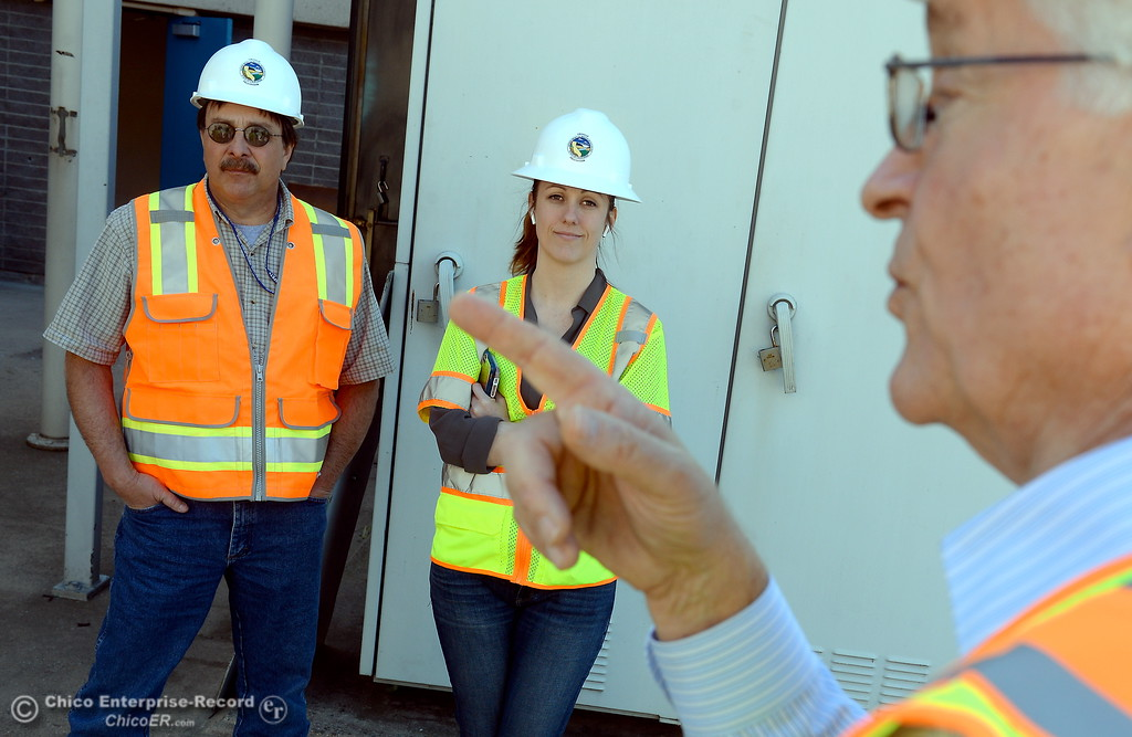 . Pat Whitlock, Oroville field division chief and Erin Mellon, assistant director of public affairs left to right listen while Tony Meyers, project manager (overseeing restoration of Thermalito facilities) talks about work currently underway at the The Ronald R. Robie Thermalito Power Plant located in Oroville, Calif. Wed. March 28, 2018.  (Bill Husa -- Enterprise-Record)
