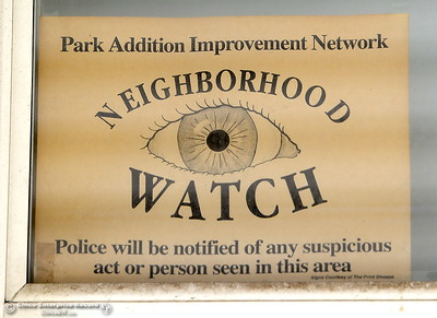An old Neighborhood Watch sign is seen posted in a window of the Tyrrell Family home in Oroville, Calif. Wed. March 28, 2018.  (Bill Husa -- Enterprise-Record)