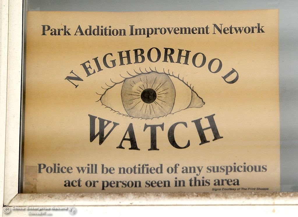 . An old Neighborhood Watch sign is seen posted in a window of the Tyrrell Family home in Oroville, Calif. Wed. March 28, 2018.  (Bill Husa -- Enterprise-Record)