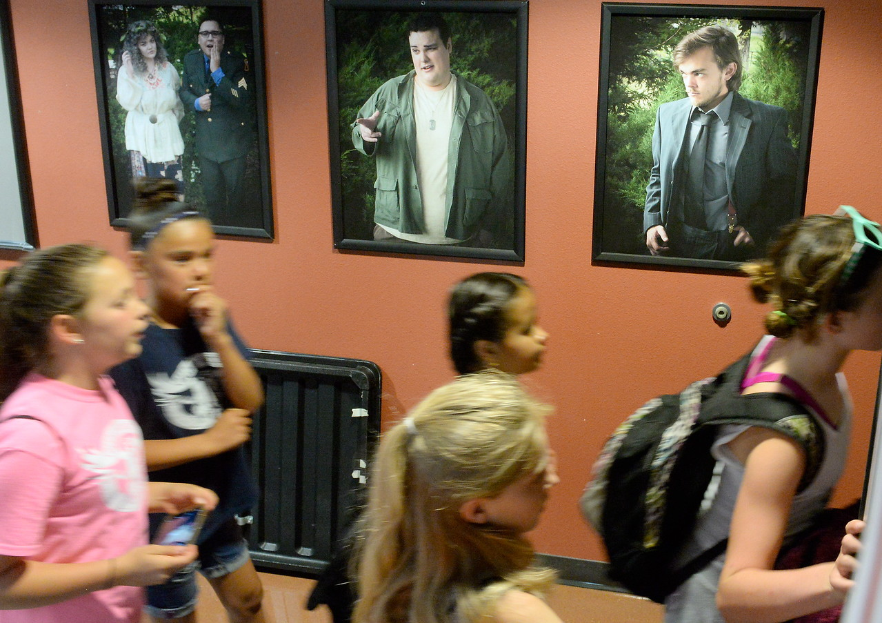 A group walks past portraits of actors as they tour the Art's building during kids challenge day in Chico, Calif. Tues. April 24, 2018. Students learned about various programs offered at the college and in some case, how much money they might expect to make with certain careers.  (Bill Husa -- Enterprise-Record)