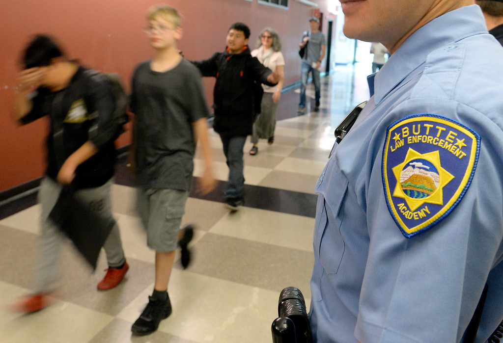 . Students walk through the Law Enforcement area during a tour of Butte College Campus during kids challenge day in Chico, Calif. Tues. April 24, 2018. Students learned about various programs offered at the college and in some case, how much money they might expect to make with certain careers.  (Bill Husa -- Enterprise-Record)