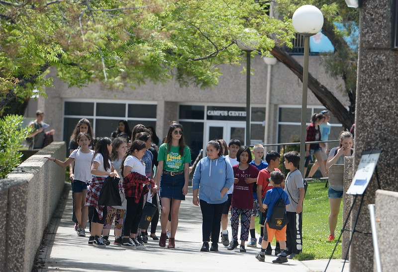 More than 450 students in grades 4-8 tour the Butte College Campus during kids challenge day in Chico, Calif. Tues. April 24, 2018. Students learned about various programs offered at the college and in some case, how much money they might expect to make with certain careers.  (Bill Husa -- Enterprise-Record)