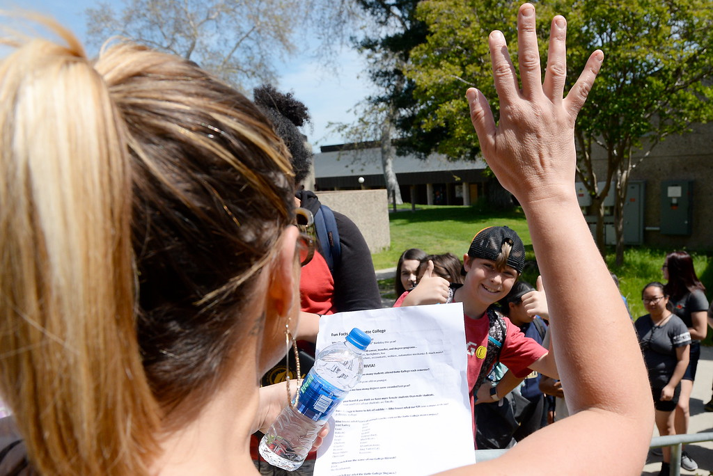 . Tour Guide and Butte College Career Services representative Carrie Soldate keeps a group of Palermo Bulldogs entertained as she and others give more than 450 students in grades 4-8 a tour the Butte College Campus during kids challenge day in Chico, Calif. Tues. April 24, 2018.  Students learned about various programs offered at the college and in some cases, how much money they might expect to make with certain careers.  (Bill Husa -- Enterprise-Record)